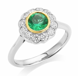 Vintage Style Round Emerald and Diamond Ring in Platinum
