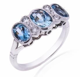 AQUA Three Stone Ring with Diamonds